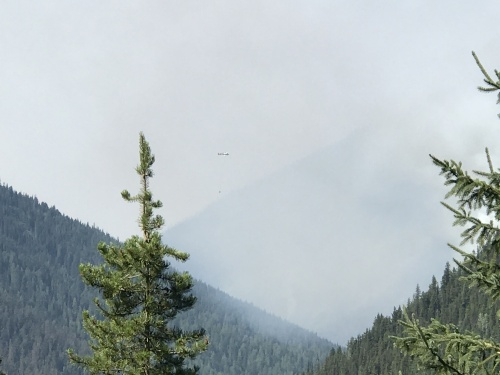 Helicopters water bombing the fire between Revelstoke and Kicking Horse